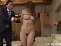 Attractive Japanese damsel in bondage delivering stunning blowjob in close up shoot