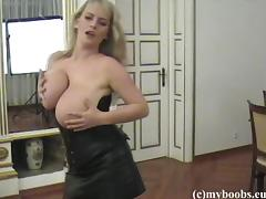 Blond mom Bea Flora wearing corset shows her big boobs