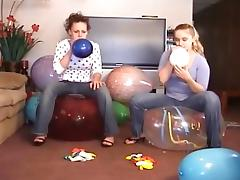 2 Girls Popping Balloons