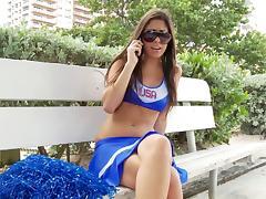 Dark-haired cheerleader with big boobs sucking a stranger's cock