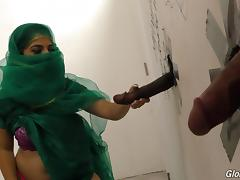 Muslim bitch sucking cocks at a gloryhole and receives a facial