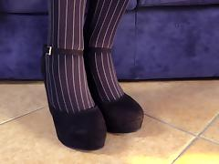 Striped blue pantyhose are beautiful on her soft feet