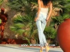 Blackhaired babe undress naked outdoors
