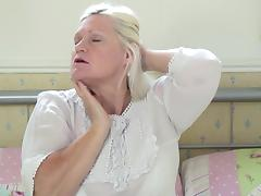 Aged blonde has massive boobs and she opted to masturbates indoors