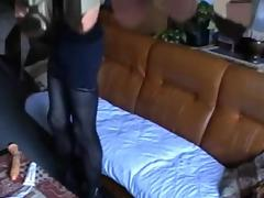Dirty crossdresser plays on a sofa