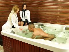 Girls in blouses climb in the hot tub for a threesome