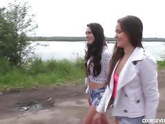 Two slim babes enjoy pleasuring their orgasmic twats on the beach