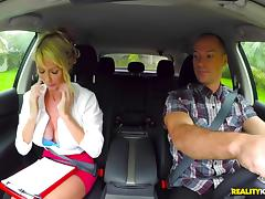 Hypnotic MILF with huge tits doing the cock riding in the car