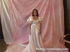 Massive love rod for a cute woman in a wedding dress