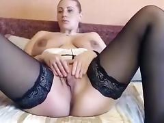 Blonde milf with big tits rubs her pussy and teasing on cam