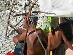 Bald nudist man fucks wife next to water