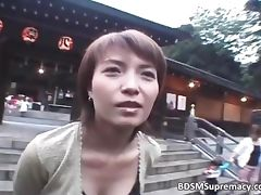 Cute brunette Asian chick shows her tits
