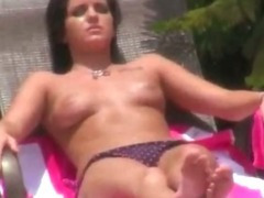 Sunbathing busty sweetie caught by a voyeur guy and fucked