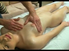 Naked girl gets massaged