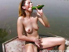 Horny brunette masturbates on a boat