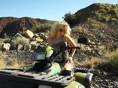 Smoking hot blond biker babe shows off her sexy body