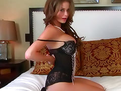 Emily Addison lying on her bed and showing her lingerie
