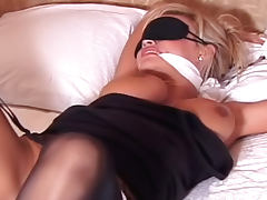 Tied blonde gets nice dose of spanking