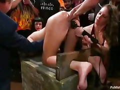 Bound babe squirt water out of asshole in public bar