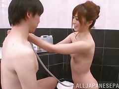 Rina Katoh gives a blowjob to a guy in the bathroom
