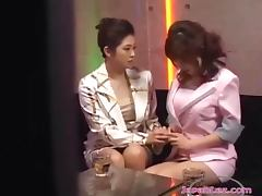 2 Asian Girls In Elegant Dresses Kissing Patting Sucking Nipples On The Couch In The Bar