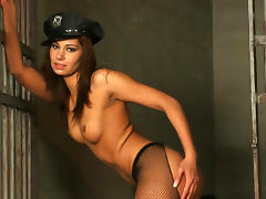 Spicy police babe bangs her hole with strapon