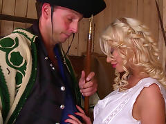 Cute curly blonde is giving a blowjob in the hayloft
