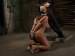 Tied up Ava Devine gives a blowjob and gets facialed