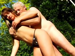 Slender Anna and Bruce are banging in the forest