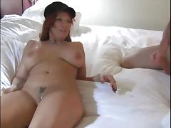 Redhead blows him, puts a condom and rides his dick