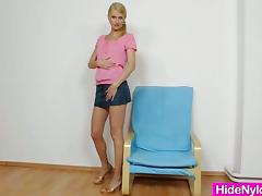 This smoking hot blonde is wearing a miniskirt and it looks good, those legs are sweet