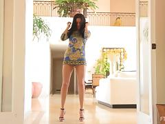 She Lifts Her Miniskirt and Rubs Her Shaved Pussy