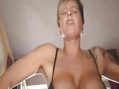 Busty milf fucks a huge bottle and fisted till she squirts